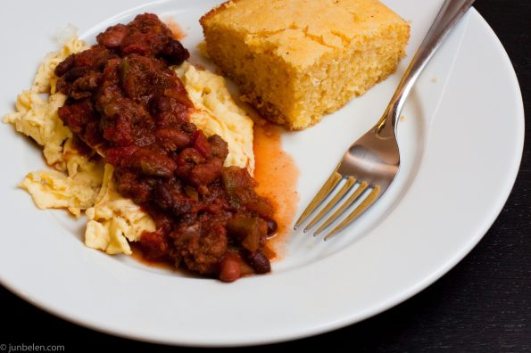 Homemade Chili Over Scrambled Eggs and Cornbread