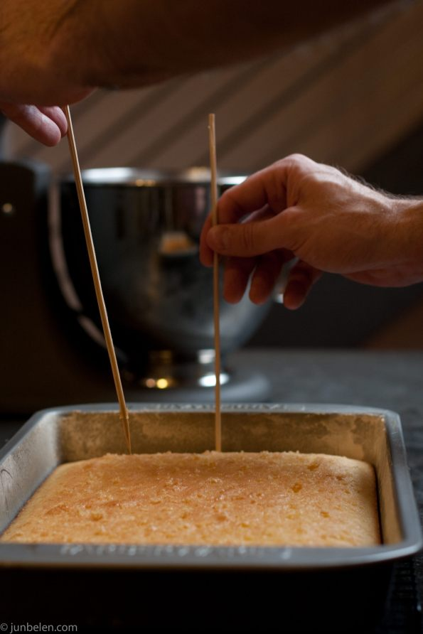 Poke the top of the cake with skewers.